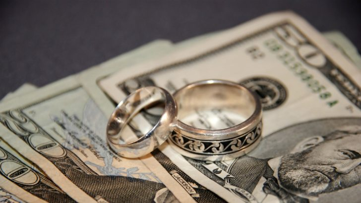 Wedding rings and money, Acquisition and merger Image credit Freeimages/Dani Simmonds