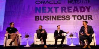 David Turner, Senior Director, EMEA Marketing, Oracle NetSuite on stage with BUILT/, Buster + Punch and OSL Cutting (Image credit Oracle)