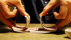 Dealing cards shuffling Image credit freeimages.com/yos1a