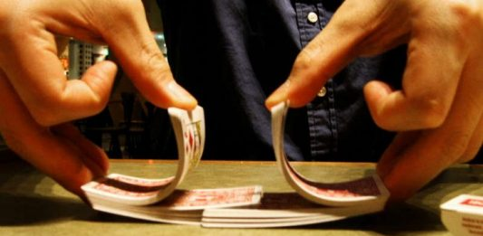 Dealing cards shuffling Image credit freeimages.com/yos1a