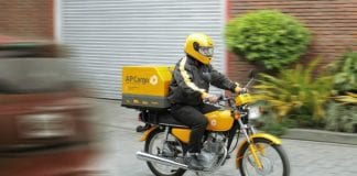 APC Delivery driver, Image credit (c) 2018 AP Cargo http://apcargo.com.ph/wp-content/uploads/2017/10/APC-Scene15-Motorcycle-Delivery.jpg