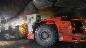 At Syama Gold mine, (c) Resolute Mining Ltd Primary-loader-hauling-ore-from-Level-1105-automation-sensor-visible-on-LHS-of-frame-sm-1024x683