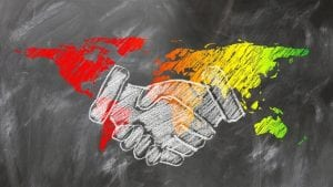 Partners shaking hands world Image by Gerd Altmann from Pixabay